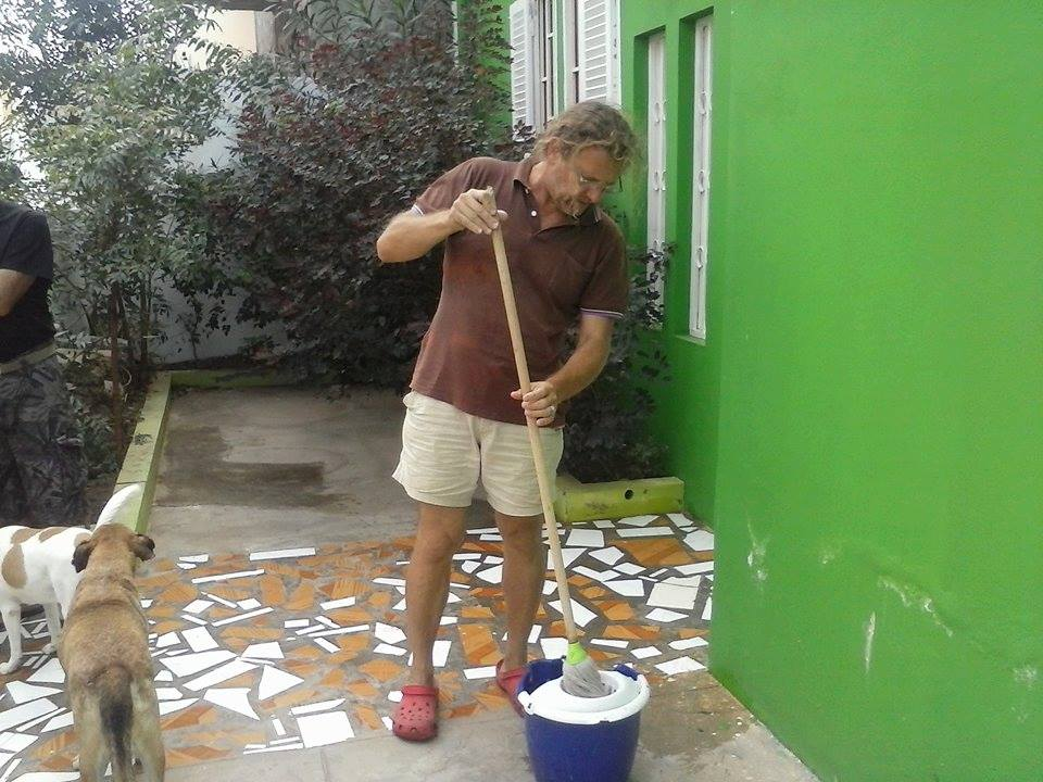 paolo manzoni cleaning simabo's hostel