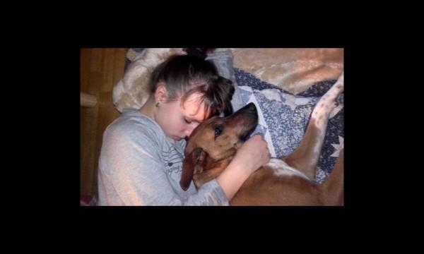 girl sleeps with her dog